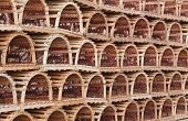 stock photo of lobster trap  - Detail view of rows of stacked lobster traps - JPG
