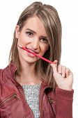 picture of midterm  - Beautiful woman college student chewing on a pencil - JPG