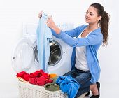 picture of washing-machine  - Happy young woman is doing laundry with washing machine at home - JPG