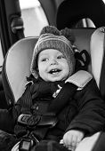 Постер, плакат: Happy Little Boy In Car Seat