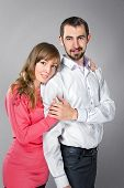 foto of friendship belt  - Young embracing couple in love posing at studiot - JPG