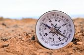 pic of orientation  - Orientation Concept Metal Compass on a Rock in the Desert - JPG