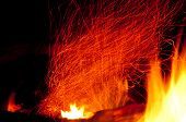 picture of ember  - Embers in a fire glow and swirl upward - JPG