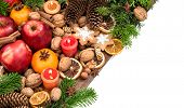 foto of tangerine-tree  - Apples candles tangerine fruits walnuts cookies and spices with christmas tree branches - JPG