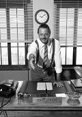 image of 1950s style  - Smiling director giving handshake in his office 1950s style - JPG