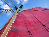 stock photo of rig  - Red Sails Mast and Ships Rigging on Schooner Sailing Ship - JPG