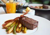 image of chateaubriand  - Fine tenderloin steak with asparagus on restaurant table - JPG