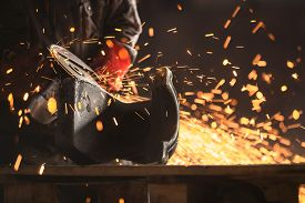 pic of welding  - Industrial Worker at the factory welding closeup - JPG