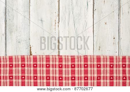 Red Checkered Tablecloth With Hearts On A White Wooden Background