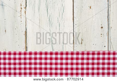 Red Checkered Tablecloth On A White Wooden Background