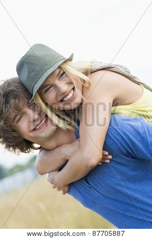 Happy young couple enjoying in field