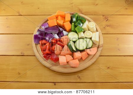 Selection Of Chopped Vegetables On A Wooden Chopping Board