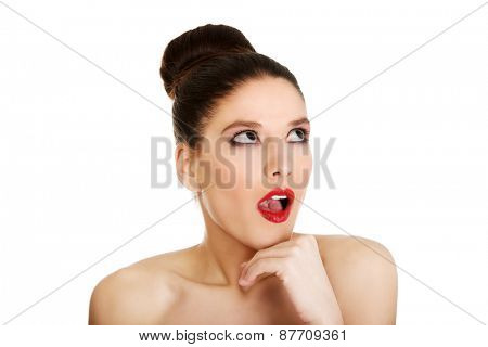 Attractive brunette shocked topless woman with dark make up.