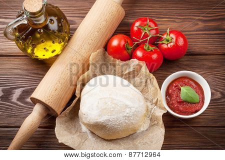 Pizza cooking ingredients. Dough, tomatoes and pasta