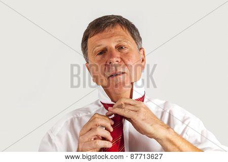 Man Binding His Tie