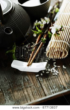 Chinese Tea Set,chopsticks and sakura branch on rustic wooden table