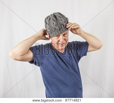 attractive man in Studio with a wool cap