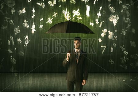 Businessman standing with umbrella and 3d numbers raining concept on background