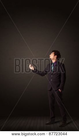 Businessman makings gestures with his hands