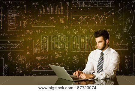 Businessman sitting at black table with hand drawn diagram background