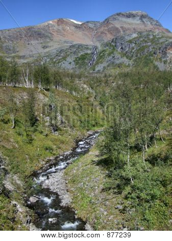 Beautiful Landscape And A Stream In Norway