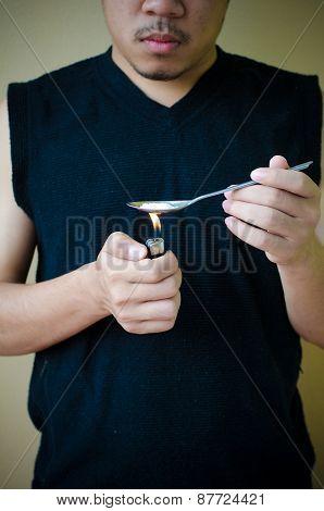 Man Prepares Drug In Spoon