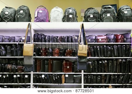 Shop With Shelves With Many Various Fashionable Men Bags And Backpacks
