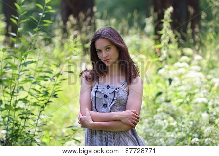 Close-up Of Beautiful Girl In Dress And Long Hair With View Of Forest In Background With Shallow Dep