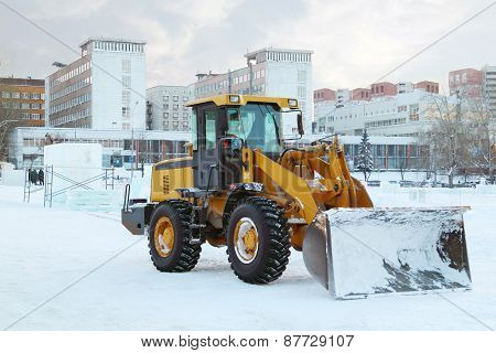 Perm, Russia - Dec 17, 2013: Bulldozer After Work In Ice Town. Construction Of Ice Town Worth 268,00