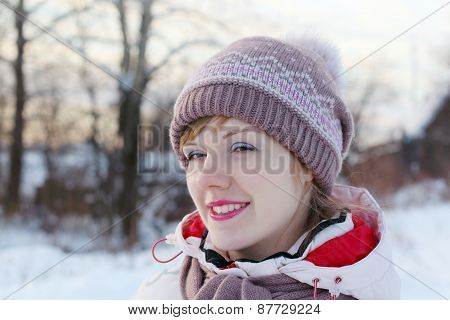 Portrait Of Young Happy Woman Looking Away At Winter Day In Village