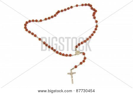 Wood rosary and metal cross with slightly unfocused beads isolated on a white background