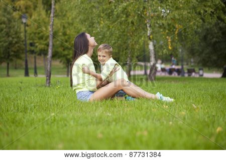 Young mother and little boy in autumn park