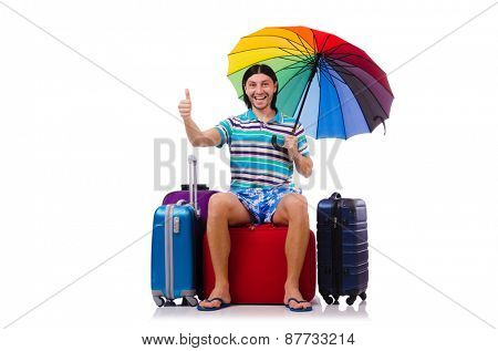 Tourist sits on bags isolated on white