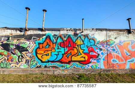 Colorful Graffiti With Chaotic Text On Gray Wall