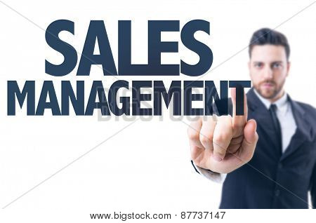 Business man pointing the text: Sales Management