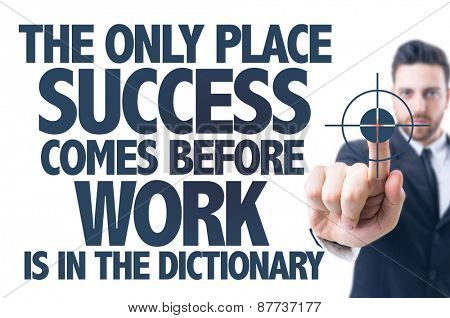 Business man pointing the text: The Only Place Success Comes Before Work is in the Dictionary