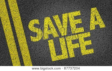 Save a Life written on the road