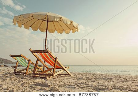 Beach chairs with umbrella at morning