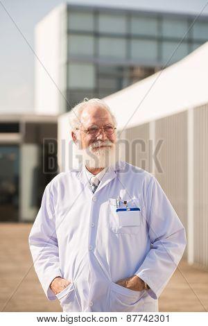 Smiling mature scientist