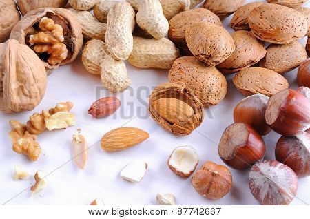 Nuts In Shell And Shelled On A Table Top View