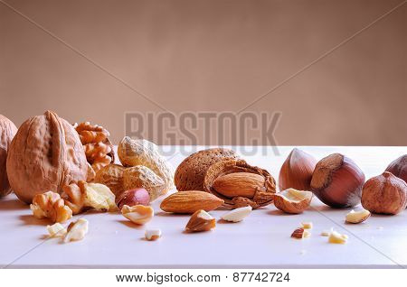 Tasty Nuts In Shell And Shelled On A White Table