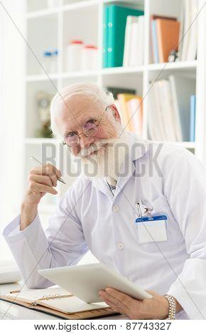 Senior scientist at his workplace