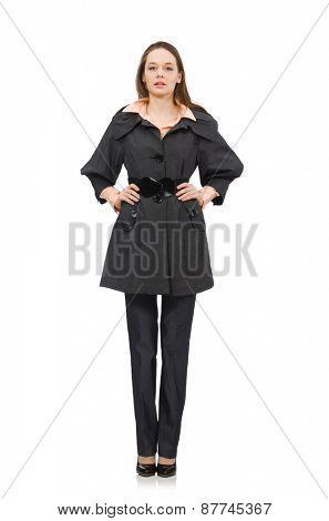 Cute girl in warm dark coat isolated on white
