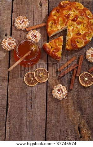 Piece Of A Pie With A Peach Stuffing And Honey In Transparent Bank