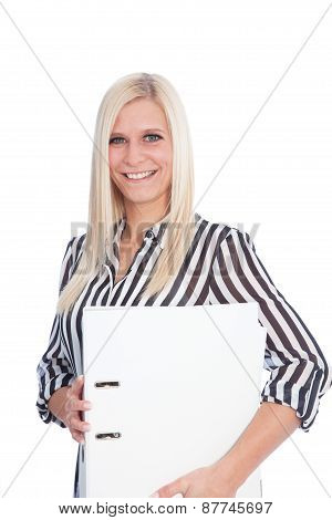 Happy Blond Woman Holding A Binder