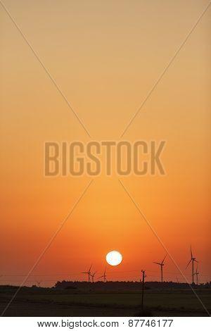Windmills silhouettes at sunrise