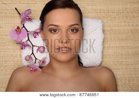Young Beauty Woman In A Spa With Closed Eyes