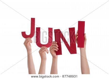 People Holding German Word Juni Means June