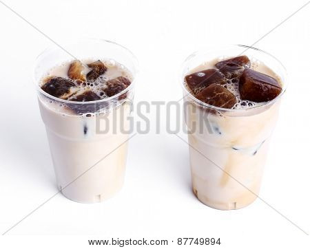 Delicious coffee with ice cubes