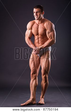 Classic bodybuilder, posing on a black background.